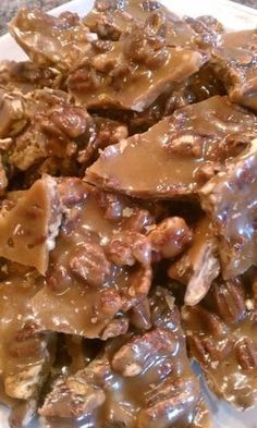Easy pecan toffee if youve never tried saltine toffee now is the time! crispy buttery toffee with crackers pecans and chocolate so easy to make too! Brittle Recipes, Fudge Recipes, Candy Recipes, Sweet Recipes, Holiday Recipes, Dessert Recipes, Pecan Toffee Recipe, Butter Toffee, Butter Pecan