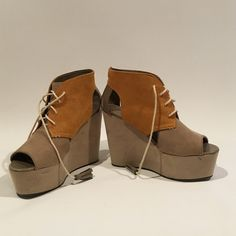 Taupe and mustard colored wedges, platforms Only worn a couple times. In good condition. Suede. Size is Euro 39 US 8 Shoes Wedges