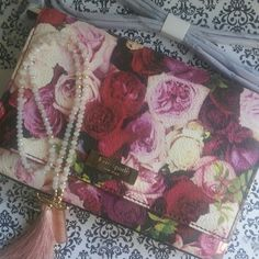"""SaleNWT KATE SPADE GRANT STREET FLORAL SALLY Brand New Photoreal Rose Print Crossbody.  Adorable and great for that extra pop of color.  Has one inside pocket beyond the main compartment.  total strap length: 44.9"""" Made on printed pvc with matching trim capital kate jacquard lining 14-karat light gold plated hardware cross body with snap closure interior slide pocket gold staple kate spade new york signature kate spade Bags"""