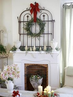 Classic Christmas Mantel     Create a winter-inspired mantel display with a secondhand gate and festive foliage. An ornate wrought-iron gate is a beautiful wall display on its own, but add a wreath, ribbon, and garland and it turns into welcoming holiday art. Just prop the gate against the wall, loop a wide ribbon through a lightweight wreath, and tie it onto the gate.