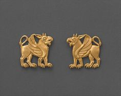 Dress ornaments    Date:      ca. 5th century B.C.  Geography:      Northern Black Sea region, possibly from Maikop  Culture:      Scythian  Medium:      Gold  Dimensions:      Each H. 1 in. (2.5 cm)  Classification:      Metalwork