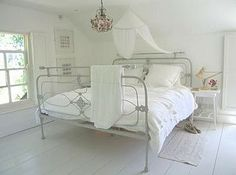 vintage iron bed...light and airy look.