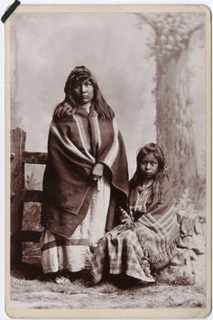 Ute Indian woman standing and a girl seated