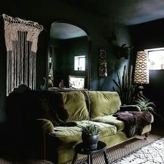 Beautiful Rooms I just want to curl up on this couch. black walls and green sofa by cowboy kateI just want to curl up on this couch. black walls and green sofa by cowboy kate Dark Living Rooms, Living Room Green, Boho Living Room, Living Room Sofa, Apartment Living, Home And Living, Living Room Decor, Dark Rooms, Patio Interior