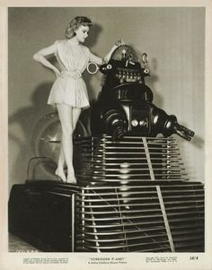 Ann Francis in Hidden Planet being 'taken for a ride' by Robbie the Robot
