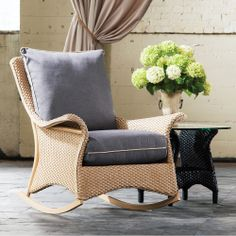 The Mandalay Lounge Rocking Chair by Lloyd Flanders showcases traditional American workmanship with a touch of modern flair.