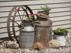 Sitting Pretty Love the rusty milk cans and the wheel. Might could use this idea on the porch or back patio. Pretty Love the rusty milk cans and the wheel. Might could use this idea on the porch or back patio.Love the rusty milk cans and the wheel. Garden Junk, Garden Yard Ideas, Lawn And Garden, Garden Projects, Milk Can Garden Ideas, Garden Planters, Garden Beds, Garden Benches, Forest Garden