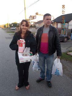 Marsha with Volunteer Grant helping us deliver to Surrey