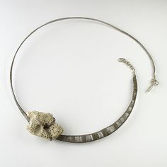 "Lena Franolic, ""continued subsistence"" necklace.  Oxidised silver wire, stone found on a beach.  2010."