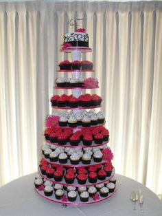 Hot Pink and Black Wedding Cupcake Tower. But with a lighter pink and little less black