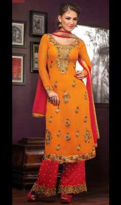 Superb craftsmanship of embellishments exhibited in this orange embroidered georgette palazzo suit. The ethnic moti, resham and stones work in attire adds a sign of beauty statement for the look. #EveningWearDress
