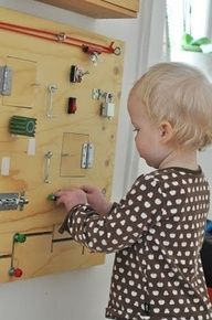Homemade busy board for  fine motor skill development - this is heaven for a curious kid!