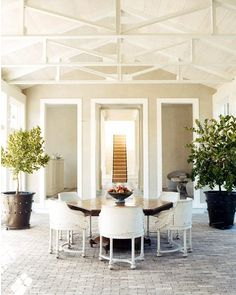 love the floors and ceiling..and the white chairs paired with a dark table