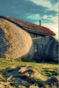 """Stone House or """"Troll's House"""" (Portugal) was just squeezed in the hole between two big boulders, and outside walls were made of small stones which had the same structure and color, so the building lives up to his name — Stone House — completely."""