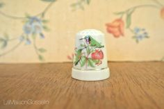 A personal favorite from my Etsy shop https://www.etsy.com/ca/listing/470898728/porcelain-hand-painted-thimble
