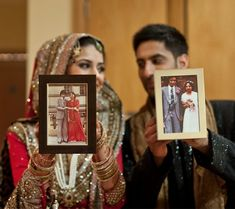 Love this idea , holding their parents wedding pictures up