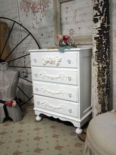 Love the floor... but especially the dresser!  I've been looking for these exact wooden appliques!