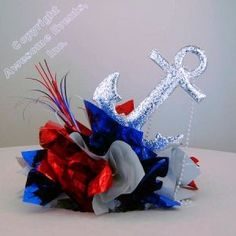 DIY Sea Anchor Centerpiece for Under the Sea theme party table decorations, bar and bat mitzvahs and weddings. Anchor Centerpiece, Navy Centerpieces, Reunion Centerpieces, Military Retirement Parties, Military Party, Retirement Ideas, Military Ball, Navy Party Themes, Us Navy Party