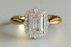 I know its a bit much....but I think I love it! Vintage Emerald Cut Diamond Engagement Ring in Yellow Gold