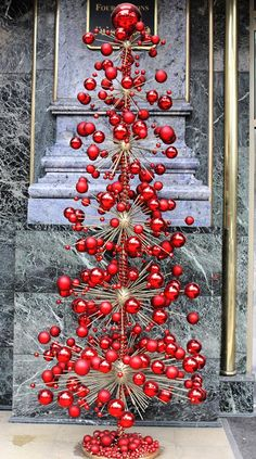 """It's almost Christmas! Very cool Christmas """"tree"""" by @Olga Moroz Power Egypt at the entrance of @Mandy Dewey Seasons Hotel Cairo at The First Residence"""