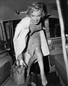 Our undated picture shows Marilyn Monroe, smiling in car. (AP Photo)