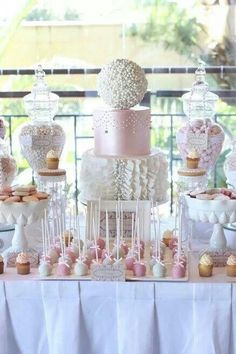 White and blush cake, candy station, and dessert bar Más