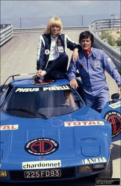 Mireille Darc and Alain Delon at Le Mans in 1980 by Michel Ginfray