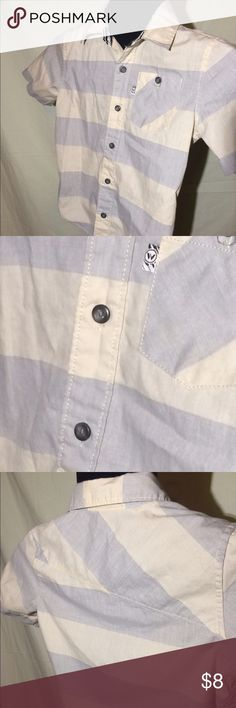Boys Shaun White Button Down Skater Shirt NWOT.  Took a closeup of the fabric. It's an off white and a light blue (almost grey) stripe.  Very light weight fabric.  Excellent condition! I consider all reasonable offers and offer quick shipping! shaun white Shirts & Tops Button Down Shirts
