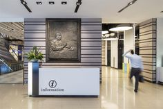 Information counter / Feature wall at Shaw Centre Singapore by DP Design