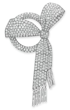 AN ART DECO DIAMOND BOW BROOCH, BY VAN CLEEF  ARPELS  Designed as a circular-cut diamond hoop, tied with a circular-cut diamond bow, suspending two articulated circular-cut diamond ribbons with baguette-cut diamond fringe, mounted in platinum, circa 1926, with French assay marks $662,500.00