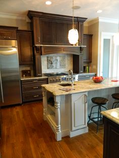 Custom kitchen island and cabinets with decorative hood range and trim