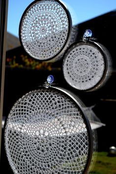 """The doilies were placed in embroidery hoops and hung on the window with suction cup hooks. """" I love the shadows these make in the sunlight."""""""