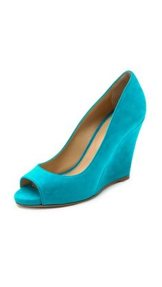 Sergio Rossi Lacker Peep Toe Wedges in Turquoise. Vibrant, velvety suede composes these sexy Sergio Rossi peep-toe pumps. Slim platform and covered wedge heel. Leather sole. Leather: Calfskin. Made in Italy. Heel: 3.5in / 90mm. Platform: 0.5in / 12mm. SALE: $312.00.