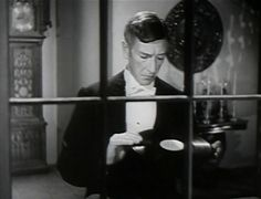 And Then There Were None - 1945 Richard Haydn as Thomas Rogers is half of the married couple who are the new servants. He is the one who plays the record that unbeknownst to him, accuses everyone of being a murderer, including his wife and himself.
