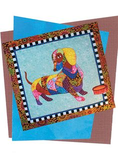 """This unique and patchwork-like pattern is perfect for the dog lover in your life. It includes fused and machine-applique instructions. Finished size is 35"""" x 33""""."""