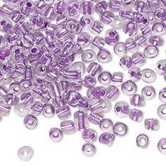 Seed bead, glass, translucent clear color-lined light amethyst purple, #6 round. Sold per 20-gram vial. ~ Fire Mountain Gems