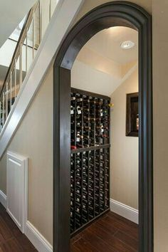Another nice use of under stair space for wine storage. Of course! HIDDEN CELLAR DOOR
