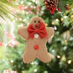 How cute is the Burlap Gingerbread Man Ornament? He's just what you need for a fun, rustic look! #Kirklands #CozyChristmas #holidaydecor
