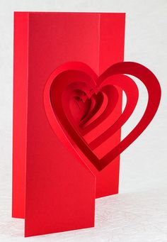 A deep red spiraling heart pop up card makes the perfect elegant Valentine for your beloved! Handmade by Andrew Crawford.