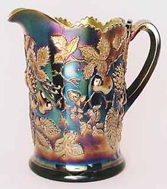 Millersburg carnival water pitcher Multi-Fruits and Flowers. Glass Jug, Fenton Glass, Green Milk Glass, Pots, Antique Glassware, Stained Glass Designs, Vintage Carnival, Indiana Glass, Carnival Glass
