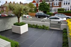 Midnight Black Limestone paving can create dramatic contrast between paler tones, pre treating the stone to intensify the colour. - All For Garden Garden Slabs, Slate Garden, Slate Patio, Wooden Garden Planters, Garden Paving, Slate Paving Slabs, Limestone Paving, Patio Slabs, Paving Stones