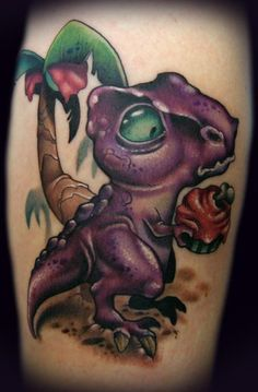 Kelly Doty - Dinosaur vs. Cupcake tattoo LOVE!! she used to work at my local tattoo shop! my sister and best friend got tattood by her, AND I love dinosaurs <3
