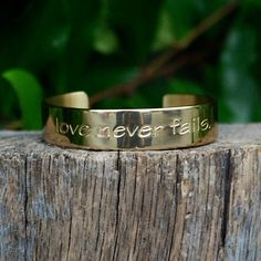 Engraved Quote Love Never Fails Gold – Rustic Cuff