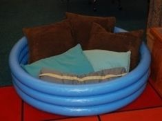 Fill an inflatable pool with pillows. | 21 Cozy Makeshift Reading Nooks