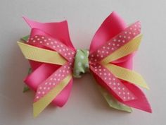 Love the colors on this hair bow. She wrapped ribbon around the center to cover the wire.