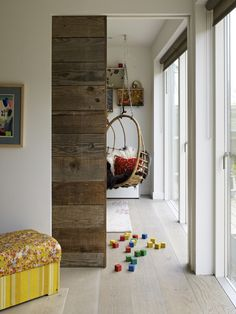 Another idea for pocket door; paneled wood white washed