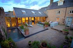 Single story extension running perpendicular to the main building created a courtyard area and a stunning interior/exterior living space.