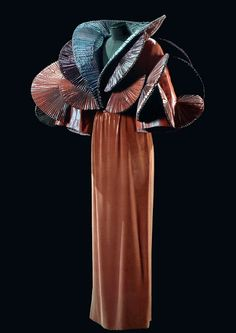 Roberto Capucci , the exhibition 'Sovereign elegance' photos of Claudia Primangeli created in 1987, this velvet dress with pleated taffeta bolero fans