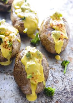 Vegan Broccoli Cheese Baked Potatoes are delicious baked potatoes topped with creamy and cheesy broccoli sauce.Make this loaded baked potato recipe!