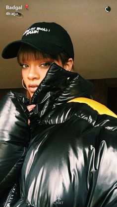 // Rihanna in Raf. It's clear that puffa jackets are going to be big for the Fall/Winter 2016 season. Spotted in nearly everything, Rihanna shared to the world her latest winter look via her Snapchat story. Rihanna was seen strutting in Raf Simons Black Down Oversized Coat, a black cap and a pair